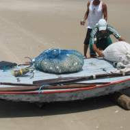 Jangadeiros pushing a Bote on the beach
