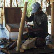 A carpenter chiseling a hole for the leg of the tabernacle beam.