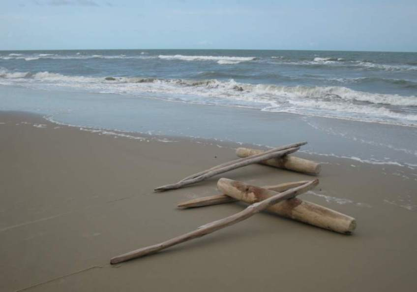 A set of rollers and tracks on the beach. These are used to move a jangada on land.