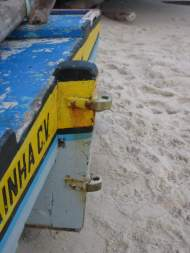 A jangadas rudder post with two bronze gudgeons.