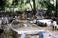 Carpenters working on the hull of a Jangada de Tábuas (planked jangada).