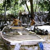 Carpenters working on the hull of a Jangada de Tábuas (planked jangada).