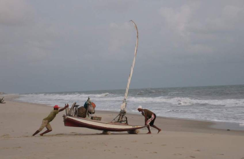 Picture series of two men leaving the beach on a paquete.